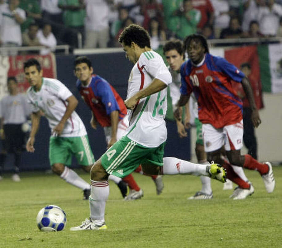 Mexico's Miguel Sabah takes a penalty kick during the second half. Sabah's shot was stopped by Costa Rica's goalkeeper. Photo: Charles Rex Arbogast, AP