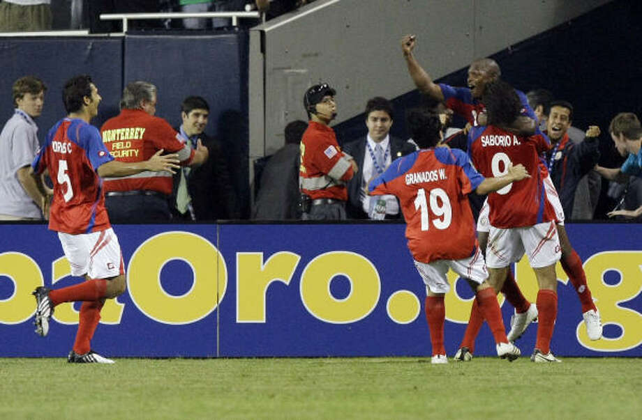Costa Rica's Froylan Ledezma is lifted by Alvaro Saborio (9) as other teammates rush in to celebrate his goal during the second half. Photo: Charles Rex Arbogast, AP