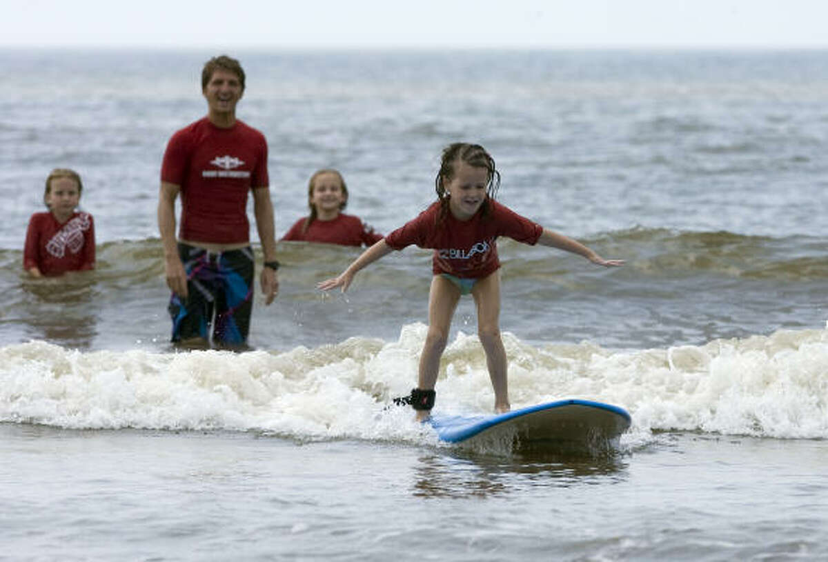 Five-year-old Olivia Oldner from McKinney, Texas rides a wave during the Bilabong / Ohana Surf and Skate Shop surf camp.
