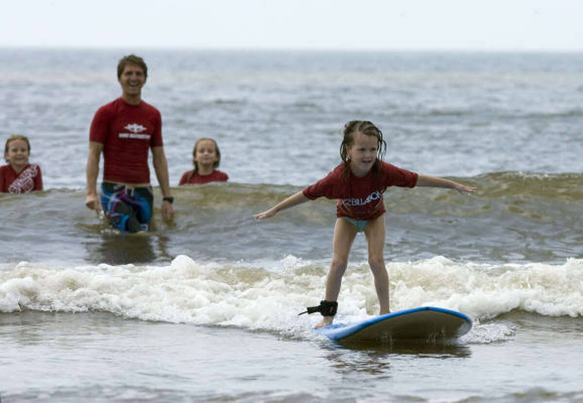 Five-year-old Olivia Oldner from McKinney, Texas rides a wave.