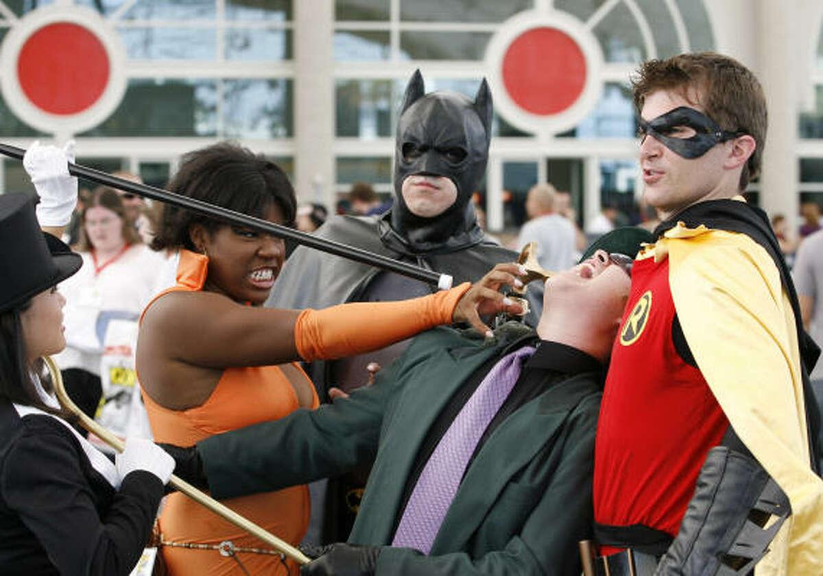 Fans dress like Batman and Robin at Comic Con.