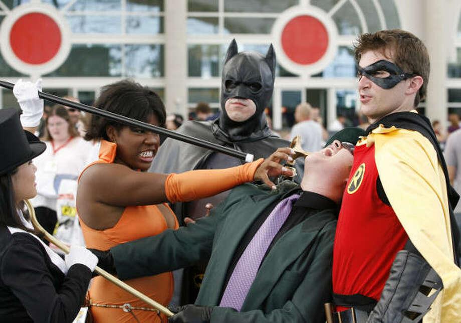 Fans dress like Batman and Robin at Comic Con. Photo: Denis Poroy, AP
