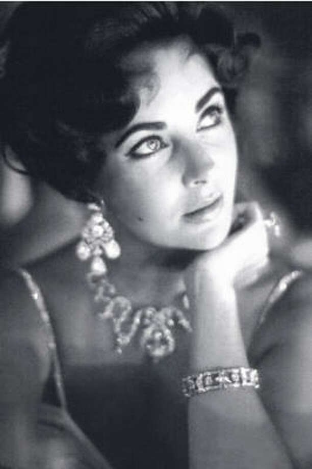 Dame Elizabeth Taylor has been a leader in celebrity fragrance with her White Diamonds collection. Photo: BW