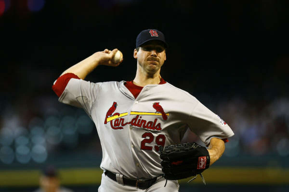 Cardinals starter Chris Carpenter delivers during the first inning. More from Richard Justice on the Astros.