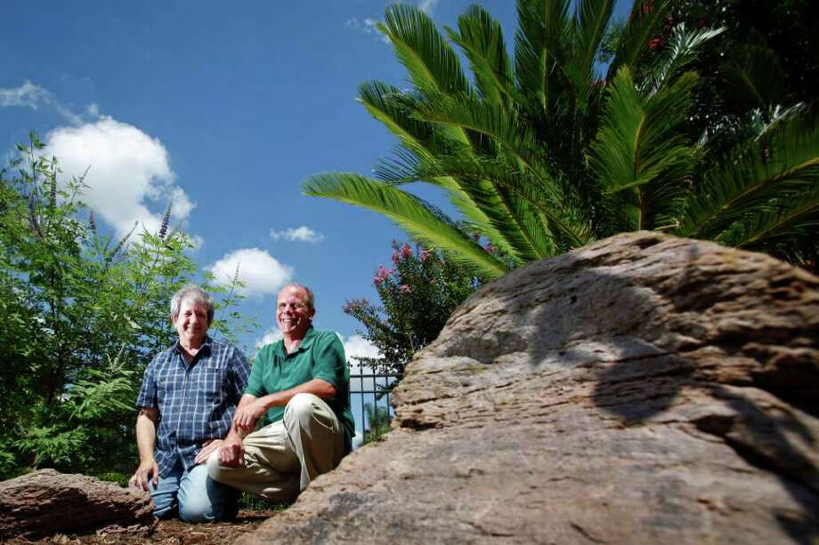 Alan Everett (left) and Douglas Anderson stand in front of the newly planted Montrose Remembrance Garden at the intersection of California and Grant Streets, Wednesday, Aug. 3, 2011, in Houston.   The garden is for the murdered victims in the area, who were targeted due to their sexual orientation.  Anderson, a friend of one of the victims, created the Aaron Scheerhoorn foundation to help people who are victims of hate crimes in the area. In Dec. 2010, Scheerhoorn was stabbed to death outside of a club in Montrose.   Anderson, along with other members of the foundation came up with the idea to have a garden in remembrance of their friend Aaron. The idea would later lead to other victims being remembered as well.   Anderson is the founder and president of the Aaron Scheerhoorn foundation.   ( Michael Paulsen / Houston Chronicle ) Photo: Michael Paulsen, Staff / © 2011 Houston Chronicle