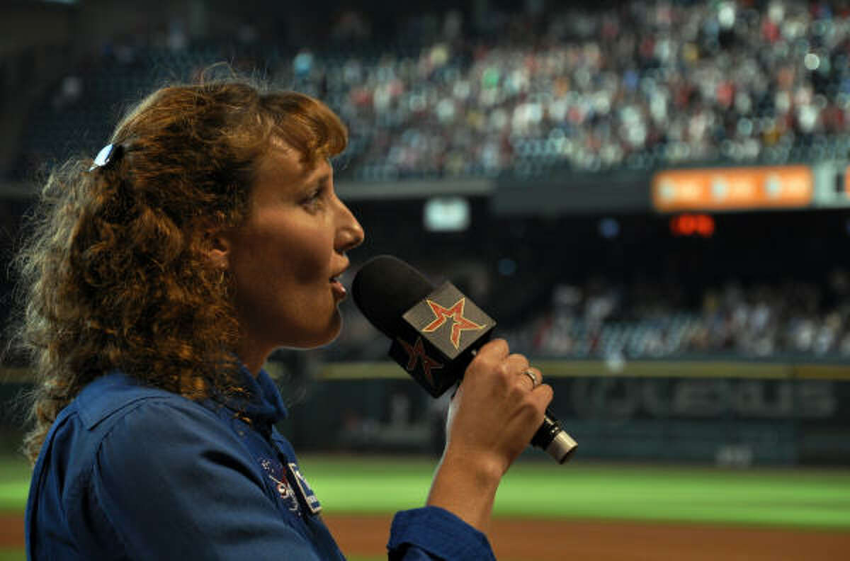 Astronaut Dottie Metcalf-Lindenbuger sings the National Anthem.