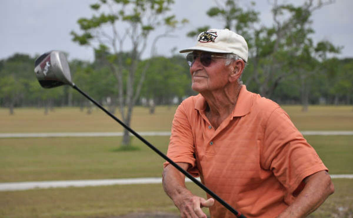 """Bill Goynes looks on as he drives a ball down the fairway at the Clear Creek Golf Course near Pearland. Earlier in the week, Goynes nailed a 128-yard drive to surprise """"The Duffers,"""" a group of golfers he plays with every Monday and Thursday in Deer Park."""