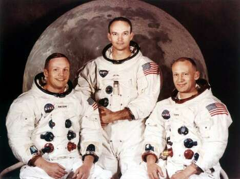 Here's who was on the rocket that day: Astronauts Neil Armstrong, left, Michael Collins, center, and Edwin A. Aldrin, are pictured in this 1969 Apollo II crew portrait. Apollo 11 video here. Photo: AP