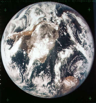 In this July 1969 file photo, most of Africa and portions of Europe and Asia can be seen in this spectacular photograph taken from the Apollo 11 spacecraft during its translunar coast toward the moon, during the month of July, 1969. Apollo 11 was already about 98,000 nautical miles from earth when this picture was made. Photo: NASA, AP