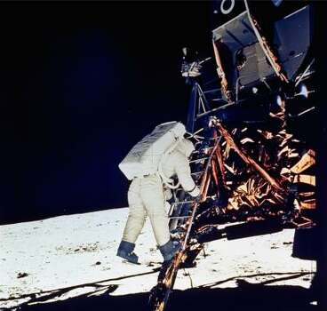 Astronaut Edwin E. Aldrin, Jr., lunar module pilot, descends steps of Lunar Module ladder as he prepares to walk on the moon, July 20, 1969.  He had just egressed the Lunar Module.  This picture was taken by Astronaut Neil A. Armstrong, Commander, with a 70mm surface camera during the Apollo 11 extravehicular activity. Photo: NEIL A. ARMSTRONG, AP