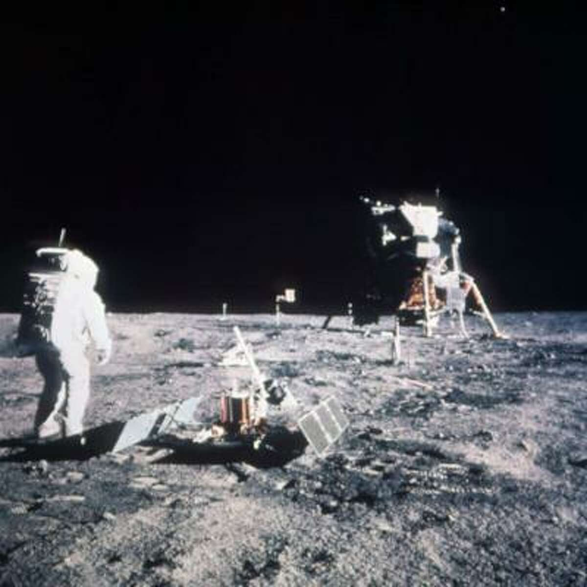 Astronaut Edwin E. Aldrin Jr., lunar module pilot, stands on the lunar surface after the Apollo 11 moon landing on July 20, 1969. The Lunar Module is seen in the background.