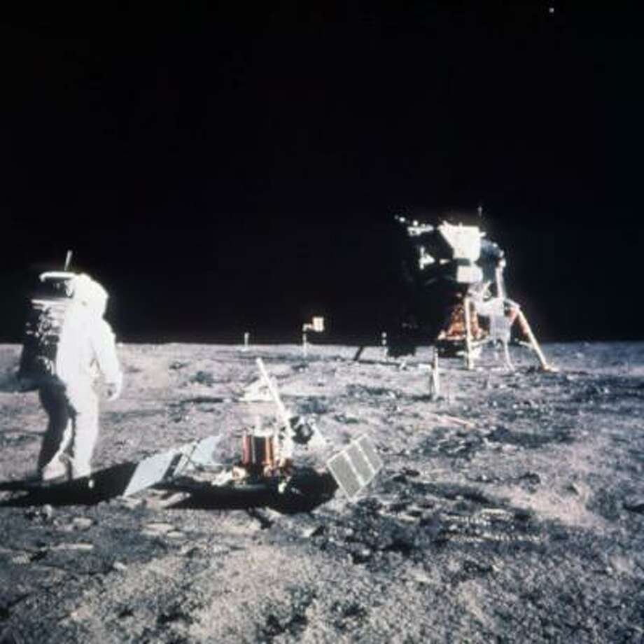 Astronaut Edwin E. Aldrin Jr., lunar module pilot, stands on the lunar surface after the Apollo 11 moon landing on July 20, 1969.  The Lunar Module is seen in the background. Photo: ASSOCIATED PRESS