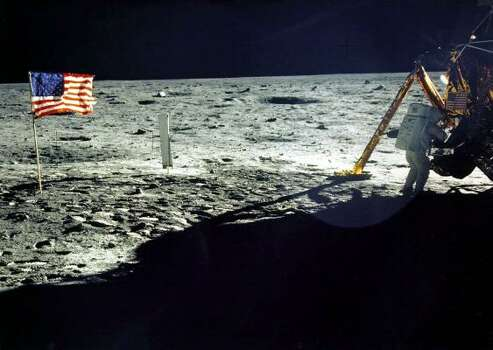 "This July 20, 1969 file photo released by NASA shows commander of the Apollo 11 mission Neil Armstrong of the US near the lunar lander and the US flag, taken by Apollo 11 astronaut Edwin E. ""Buzz"" Aldrin, Jr. on the surface of the Moon. With one small step off a ladder, Neil Armstrong became the first human to set foot on the moon on July 20, 1969, before the eyes of hundreds of millions of awed television viewers worldwide. With that step, he placed mankind's first footprint on an extraterrestrial world and gained instant hero status. Photo: NASA, AFP/Getty Images"