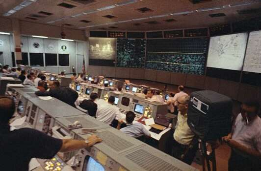 In this July 20, 1969 file photo provided by NASA, mission control personnel watch the moon walk by Apollo 11 astronauts, in Houston. Photo: Anonymous, AP