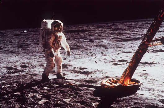 In this July  1969 file photo,  Astronaut Edwin Aldrin walks by the footpad of the Apollo 11 Lunar Module. Photo: NASA, AP