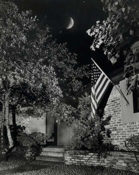 The Moon hangs high over the Neil Armstrong residence in El Lago, but when this picture was taken, Mrs. Janet Armstrong, her children, and a few friends were watching her husband, Neil and fellow astronaut Edwin Aldrin walk around on the surface of the Moon. Photo: Curtis McGee, Houston Chronicle