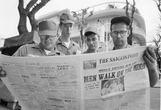 American servicemen pause on a downtown Saigon Street to read a local newspaper account of the Apollo 11 lunar landing, July 21, 1969, Ho Chi Minh City, Vietnam. From left are Air Force. Sgt. Michael Chivaris, Clinton, Mass., Army Spec. 4 Andrew Hutchins, Middlebury, Vt.; Air Force Sgt. John Whalin, Indianapolis, Ind.; and Army Spec. 4 Lloyd Newton, Roseburg, Ore. Photo: ASSOCIATED PRESS