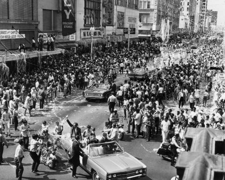 Main Street Houston - Astronaut Neil Armstrong, first man on the moon, waves to Houstonians who came by the thousands August  16, 1969 to cheer the Apollo 11 astronauts, Armstrong, Aldrin and Collins after their historic moon landing in July. Photo: JIM COKER, HOUSTON CHRONICLE