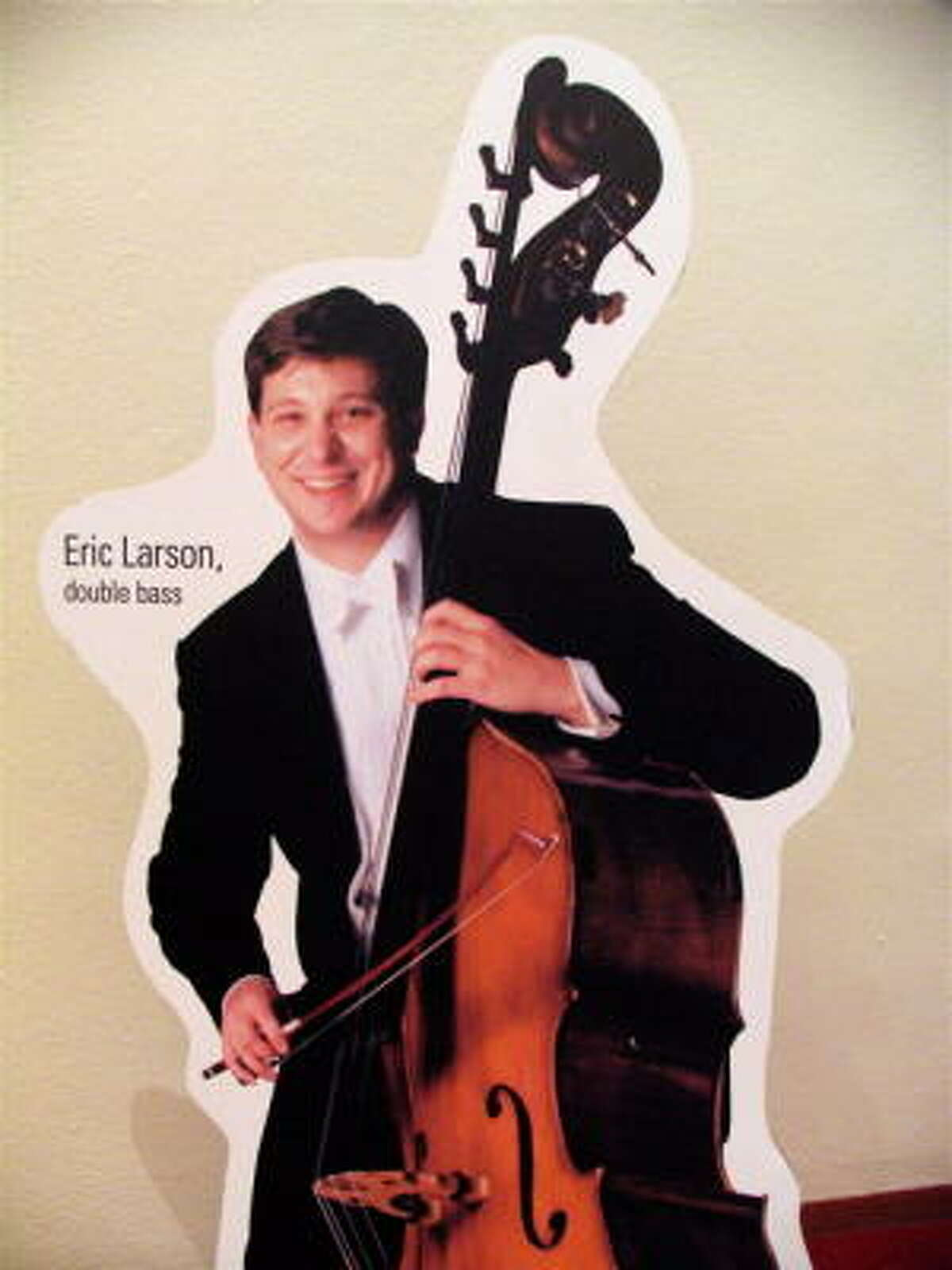 There are cardboard cut-outs of Houston Symphony orchrestra members spread all over Jones Hall. They're a tad smaller than