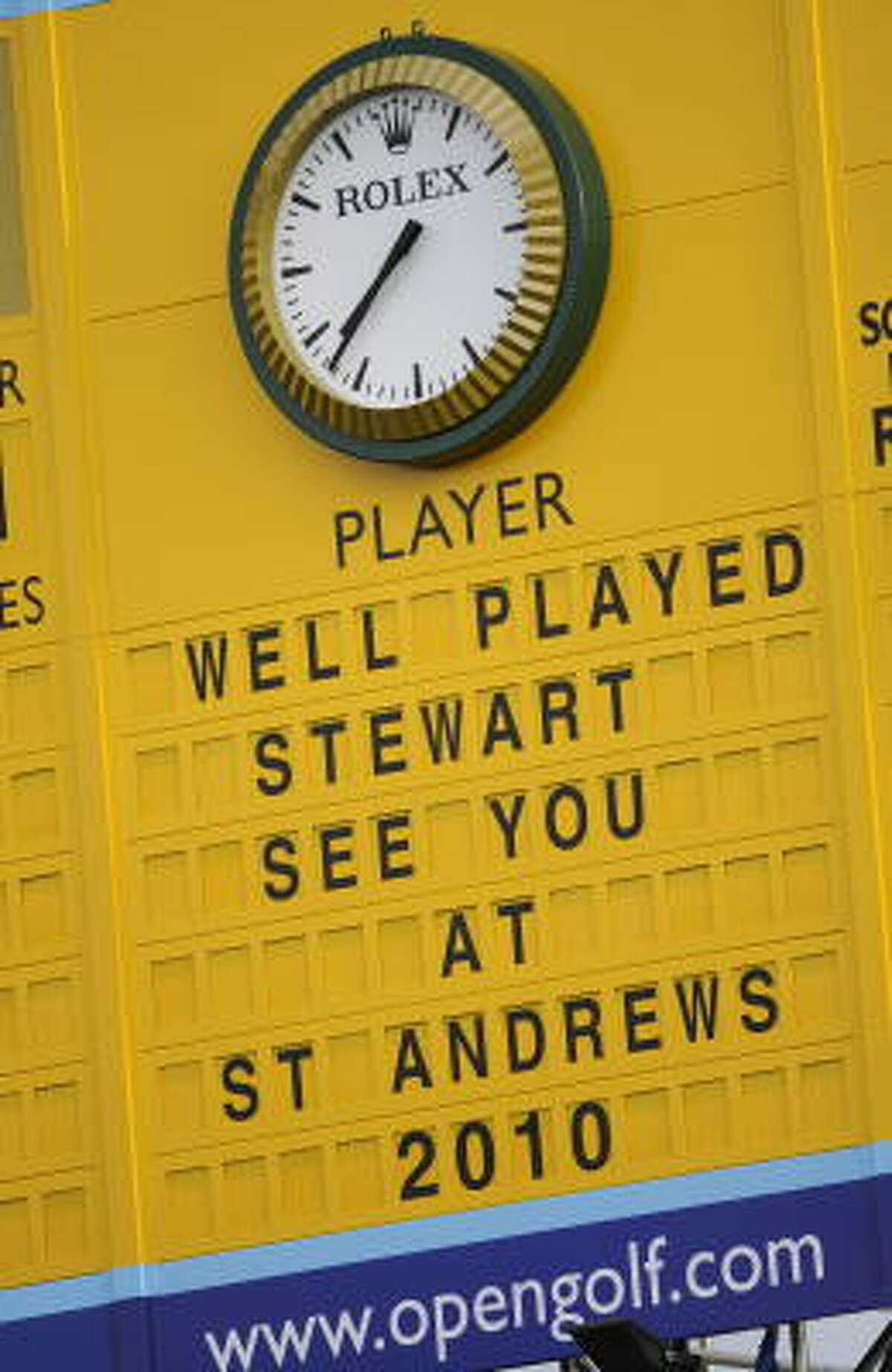 A sign on the scoreboard congratulates Stewart Cink for winning the British Open.