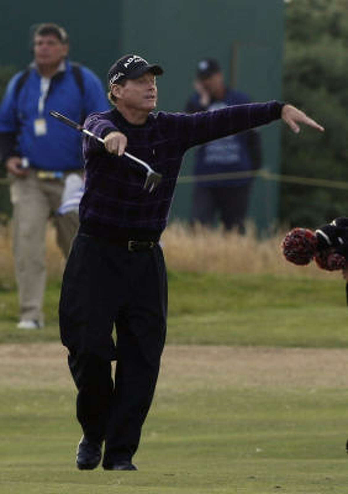 Tom Watson greets the crowd on the 18th green during the third round of the British Open.
