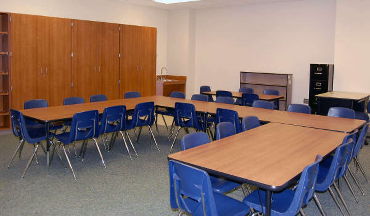 Classrooms at Mossman will use tables instead of desks to promote collaboration.