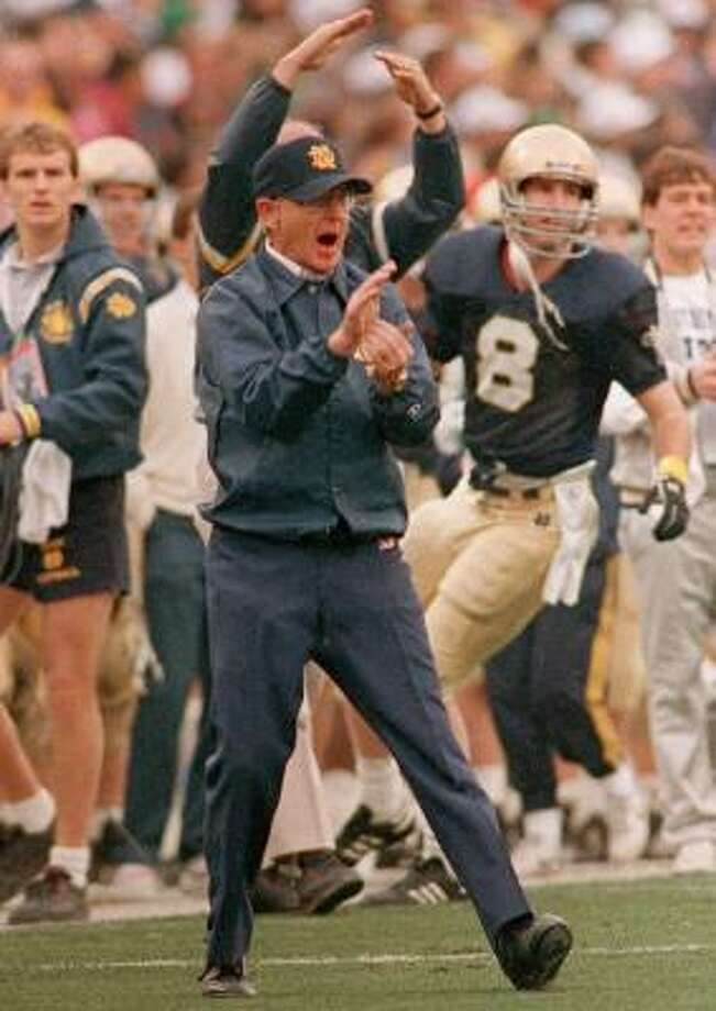 FILE--Notre Dame head coach Lou Holtz cheers for his team against West Virgina in the Fiesta Bowl in Tempe, Ariz. in this Jan. 2, 1989 file photo. Holtz is leaving his CBS football analyst position to take the head coaching job at struggling South Carolina, the network's Internet site, CBS Sportsline, reported Thursday, Dec. 3, 1998. Photo: JEFF ROBBINS, AP