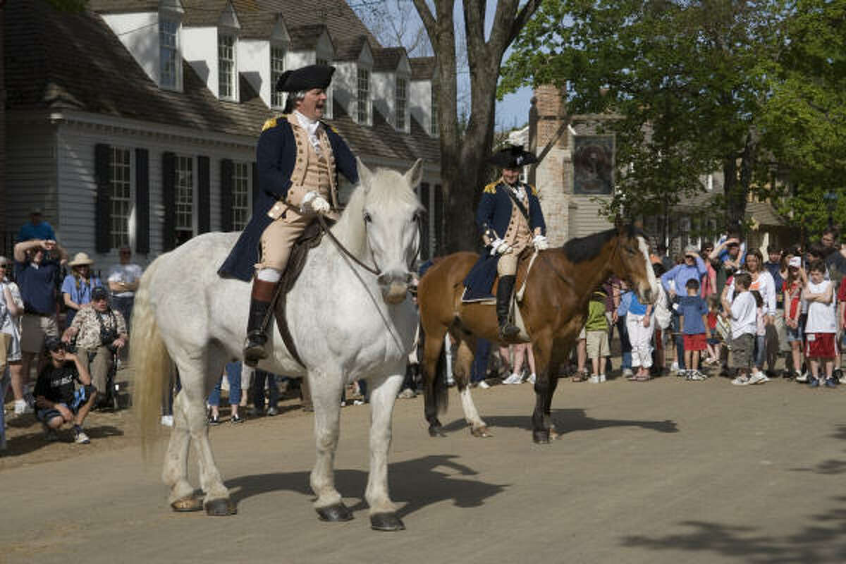 Actors portraying George Washington and the Marquis de Lafayette re-enact a scene.