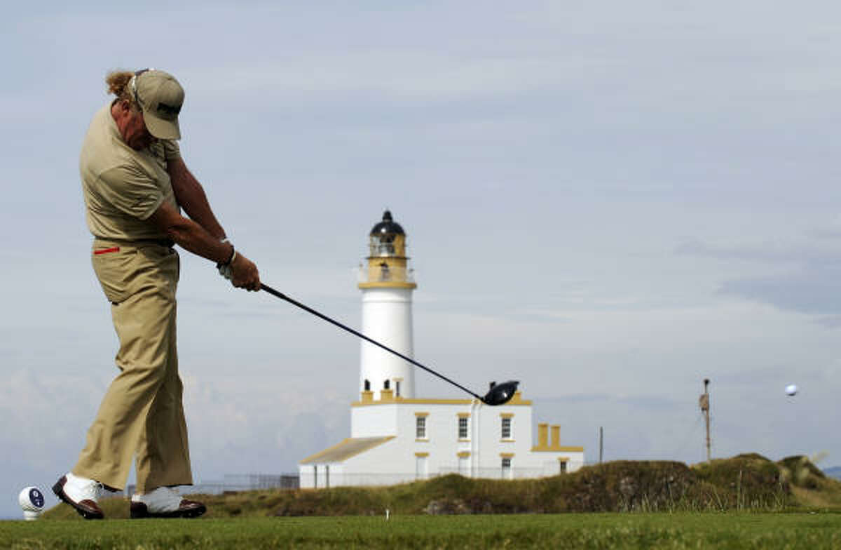 Miguel Angel Jimenez drives on the ninth tee on the first day of the British Open. Jimenez finished with a 6-under 64.