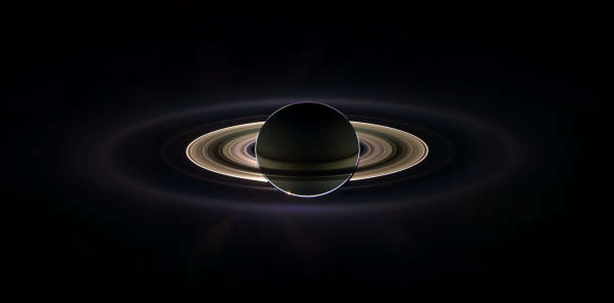 Out of sight. This lovely photo of Saturn was part of a film commissioned by the Houston Symphony when they performed Holst's The Planets.