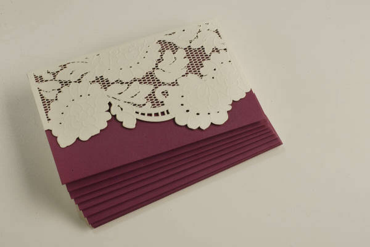 "Vera Wang ""Lace"" laser-cut and embossed cards, $33.75 for 10, Bering's"