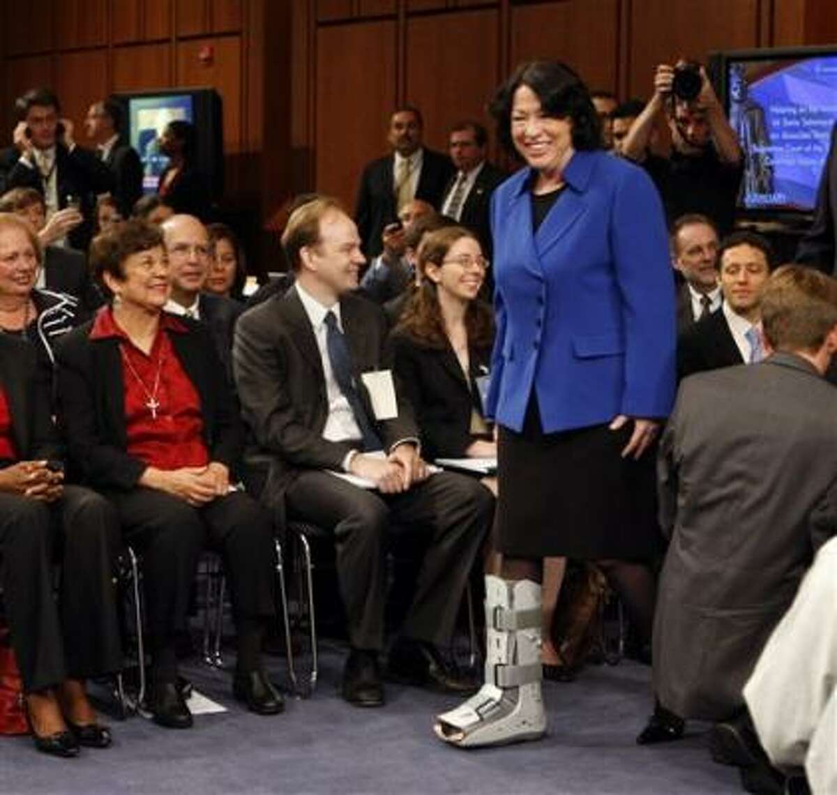 The nominee arrives for a day of testimony. She is still being treated for a broken ankle from five weeks ago. More coverage of Sotomayor here.