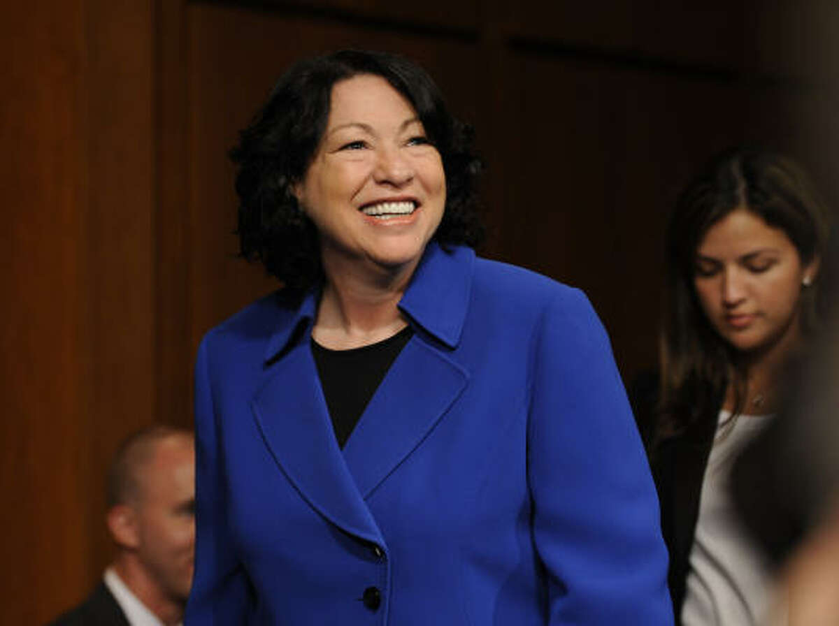 Supreme Court nominee Sonia Sotomayor arrives for the hearing. Her compelling life story was expected to be a central part of the proceedings. More coverage of Sotomayor here.
