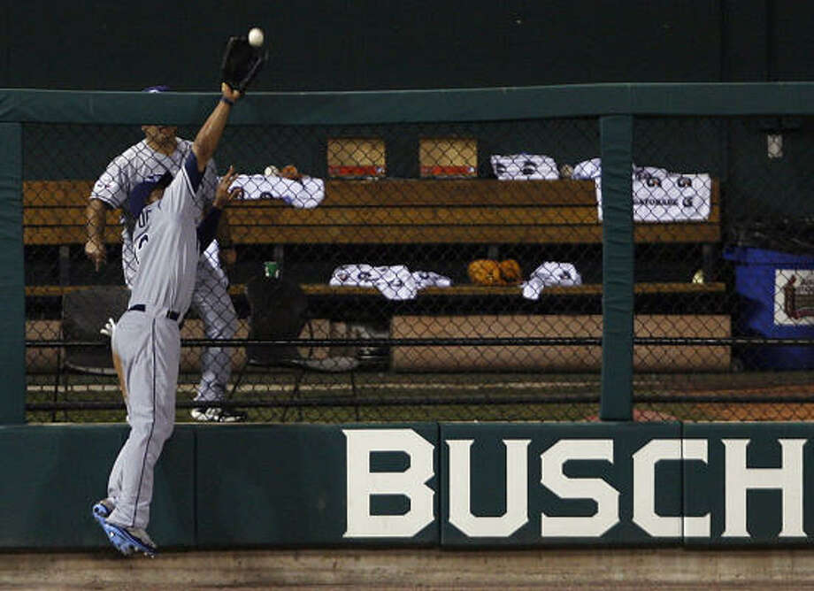 This leap over the 8-foot fence in left field in St. Louis earned Houstonian Carl Crawford of the Devil Rays an MVP award that's named for another left fielder: Ted Williams. Photo: Tom Gannam, AP