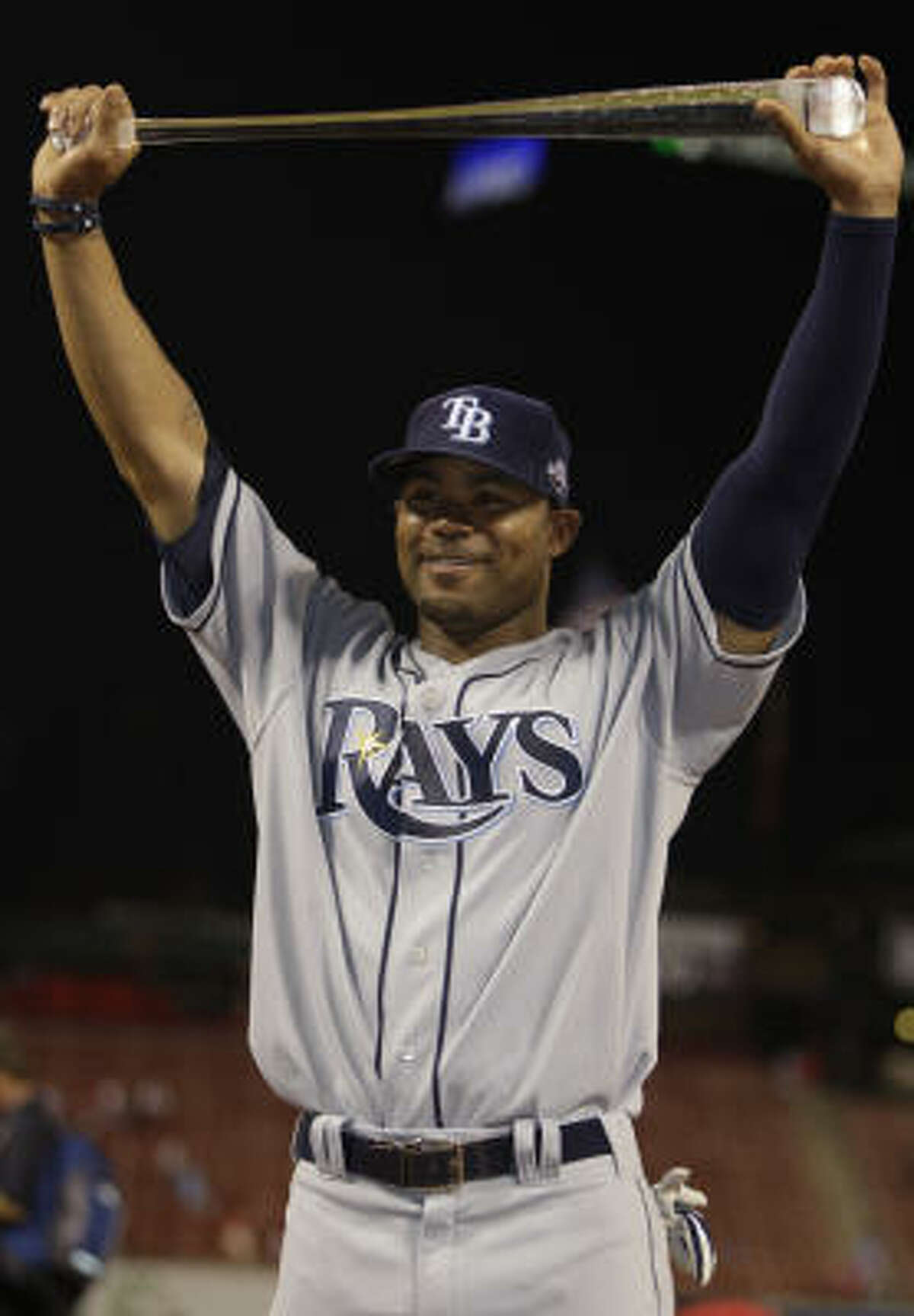 American League's Carl Crawford of the Tampa Bay Rays holds the MVP trophy.
