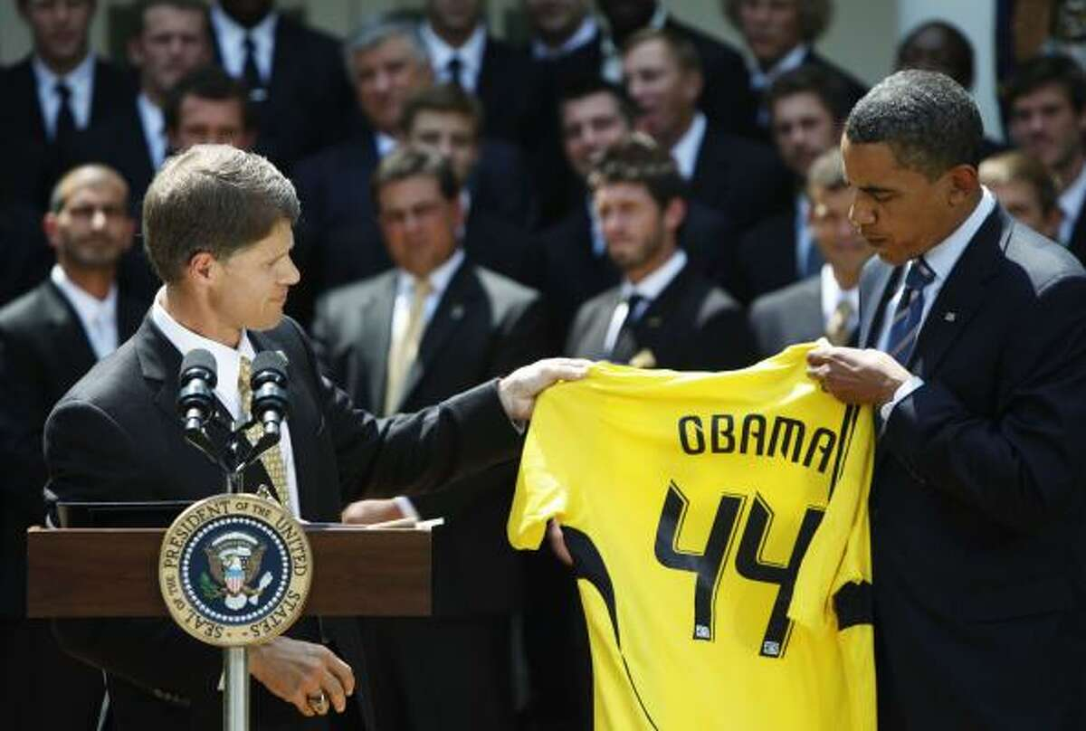 President Barack Obama is presented a jersey from Clark Hunt, owner of the Columbus Crew, in the Rose Garden.