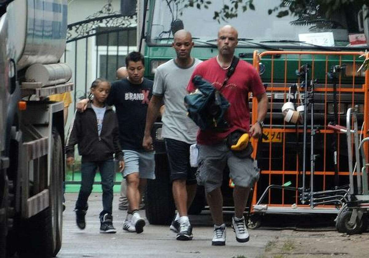 Actor Will Smith, second from right, and his daughter Willow Smith, left, are in Beijing for the filming of the movie Kung Fu Kid, a remake of The Karate Kid. Read the story here.