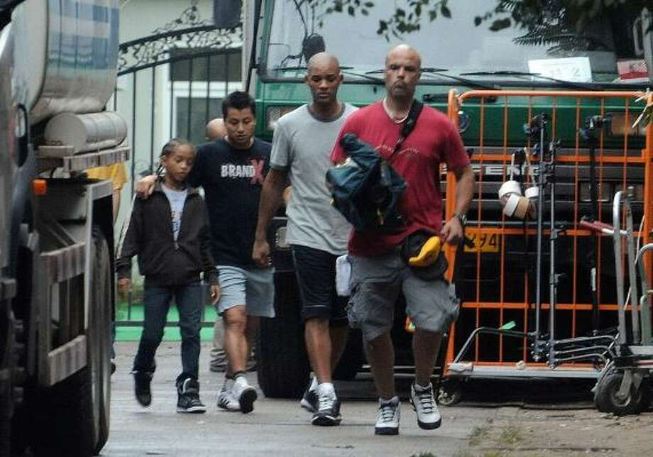 Actor Will Smith, second from right, and his daughter Willow Smith, left, are in Beijing for the filming of the movie Kung Fu Kid, a remake of The Karate Kid. Read the story here. Photo: AP