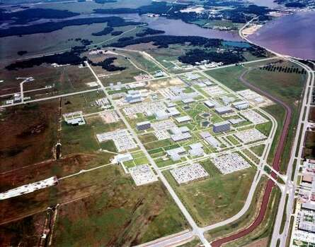 An aerial view of the Manned Space Center in 1968 shows the Apollo-era space center. At the lower left is land where Space Center Houston is now. At right, follow NASA Road 1 up to the edge of Clear Lake and on toward El Lago, another popular place for astronauts to live. Photo: NASA