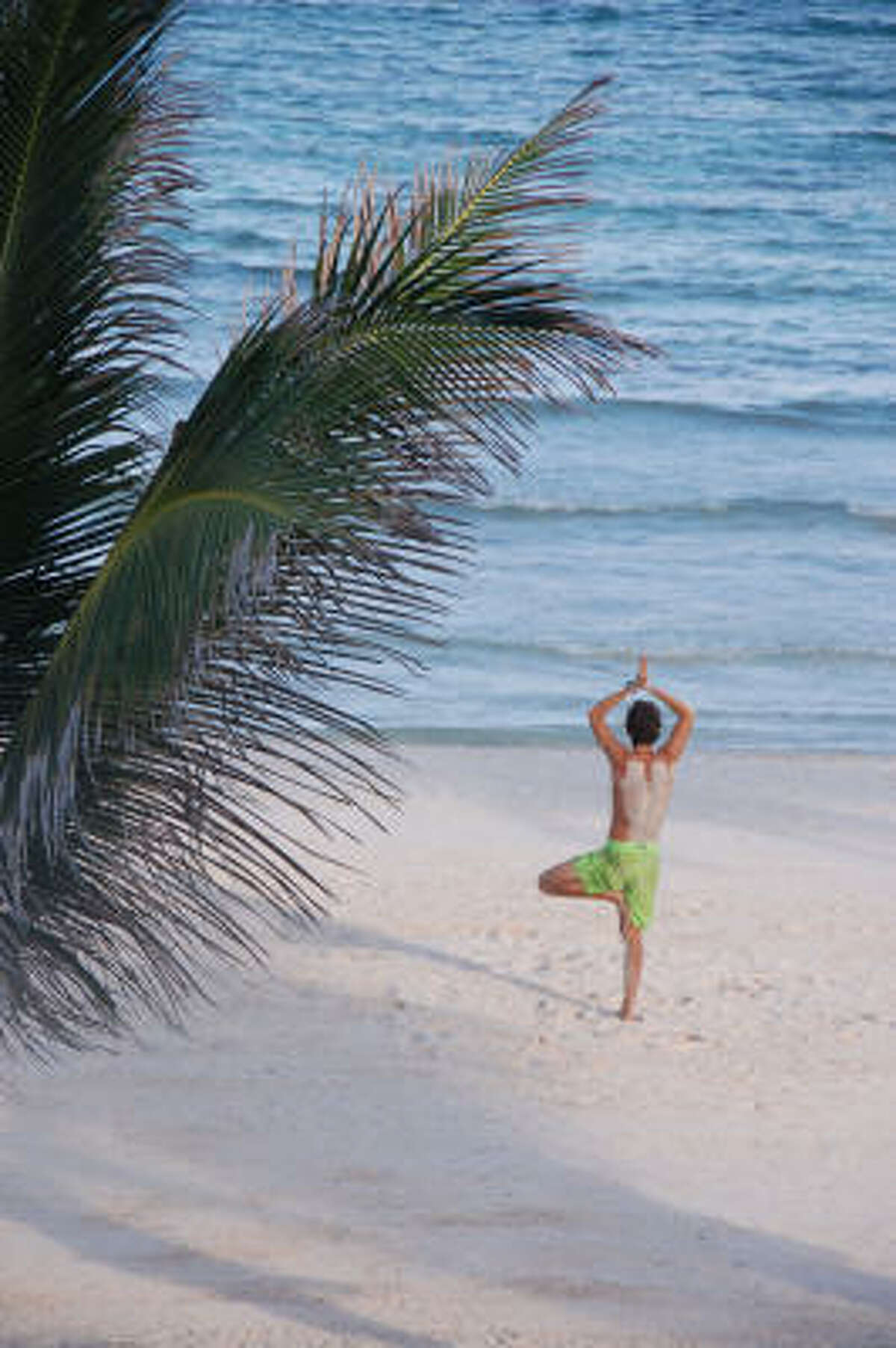 A beach-goer takes a relaxing stance at the Grand Velas All Suites Spa and Resort on the Riviera Maya. Read more about the sights of the Yucatan.