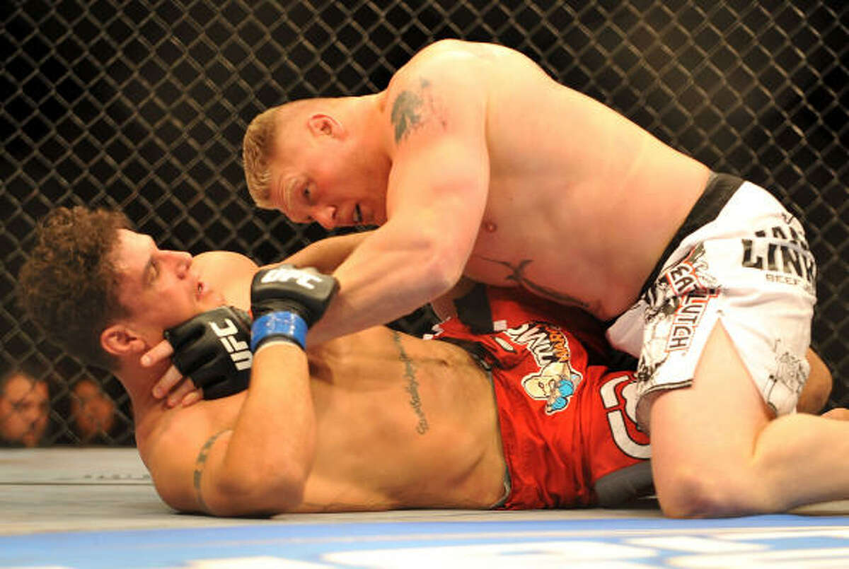 Brock Lesnar holds down Frank Mir during their heavyweight title bout at UFC 100 on Saturday at Mandalay Bay in Las Vegas, Nev.
