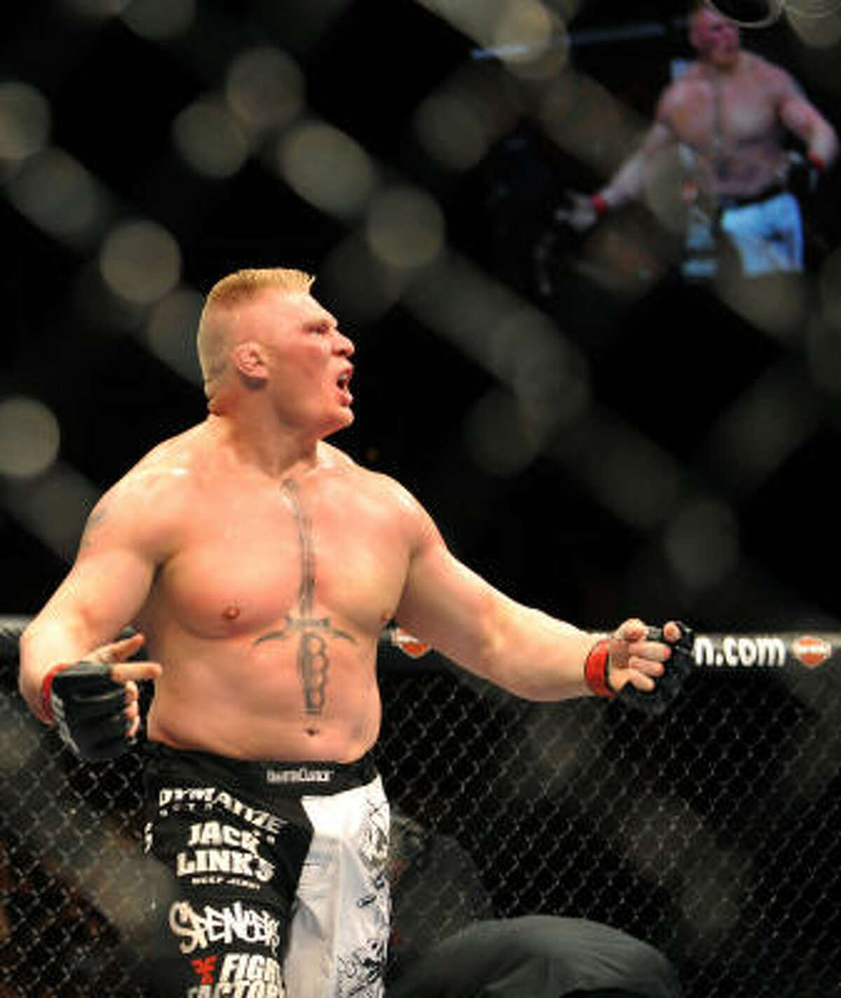 Lesnar reacts after knocking out Mir in the second round to defend his championship and avenge his only UFC loss. Lesnar fell to Mir in his UFC debut.