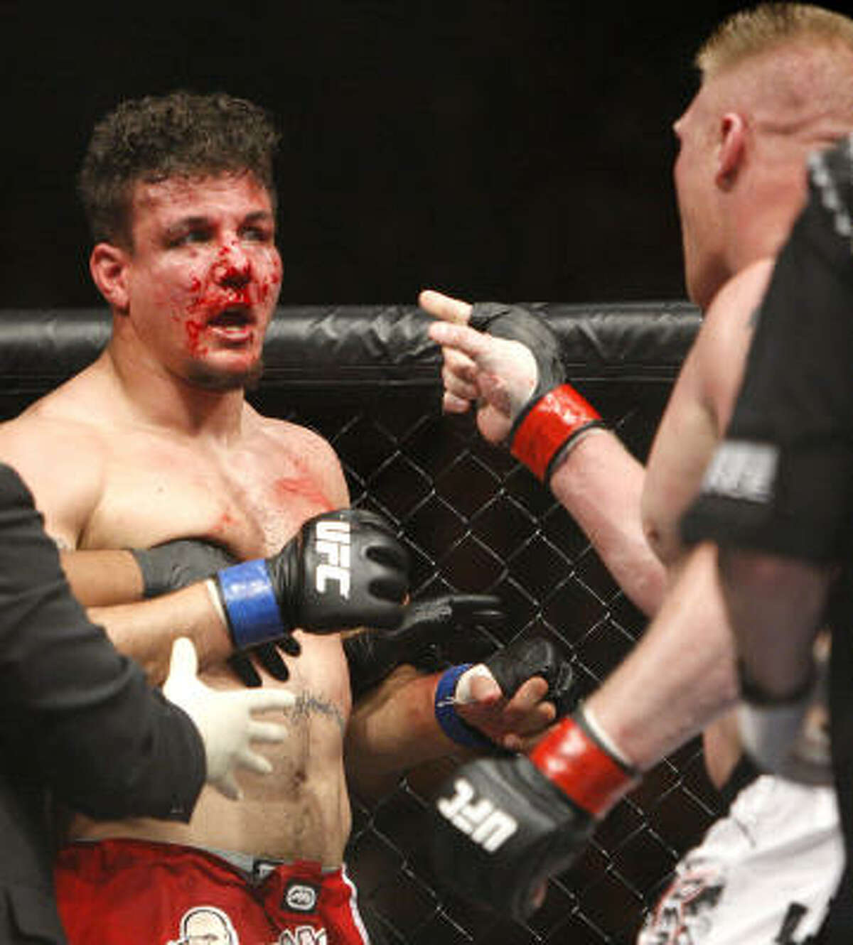Lesnar, right, gets in Mir's bloodied-up face after their fight.