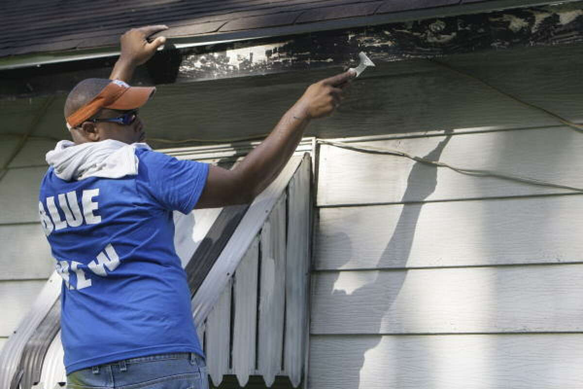Harold Jones paints during an event with the Houston Police Department's Blue Crew.