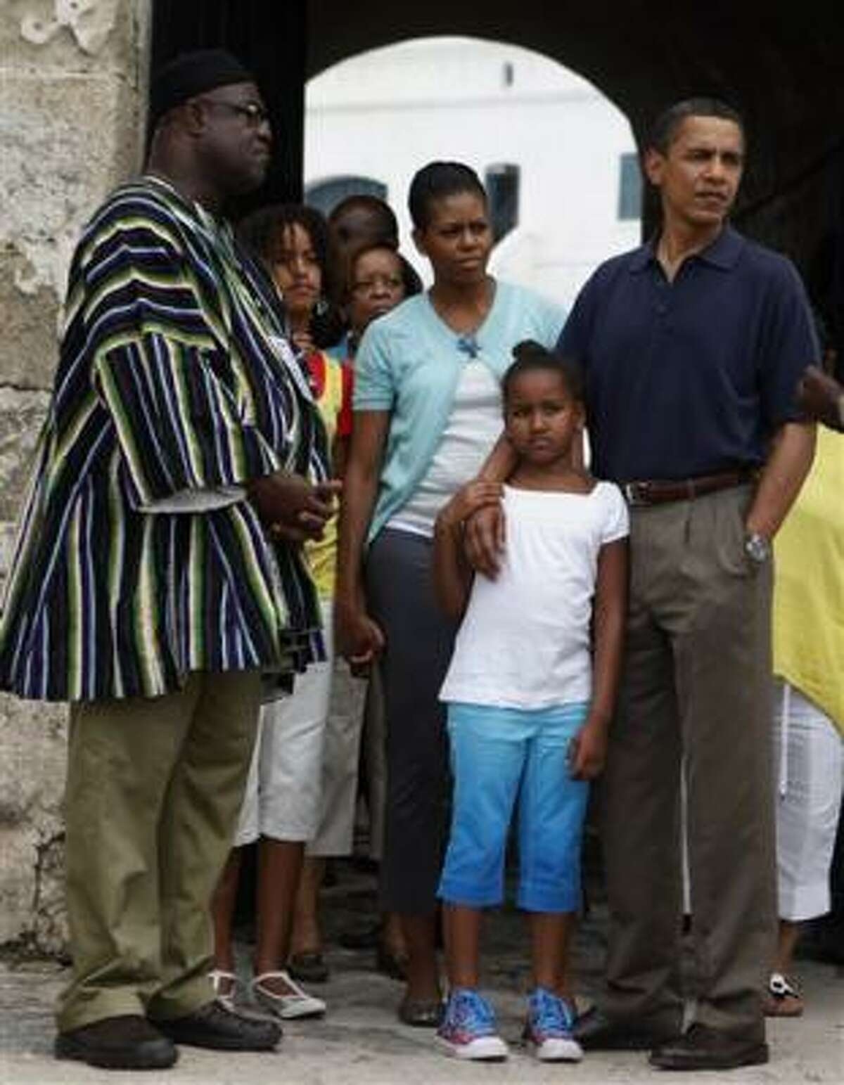 The president and his family tour Cape Coast Castle, a notorious slave port, in Cape Coast, Ghana, on July 11. The president was moved by the tour.