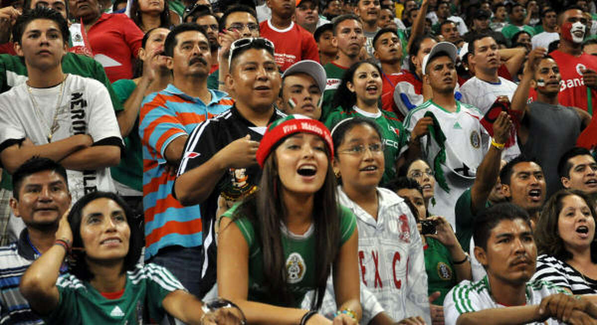 Fans react to a missed shot on goal by team Mexico