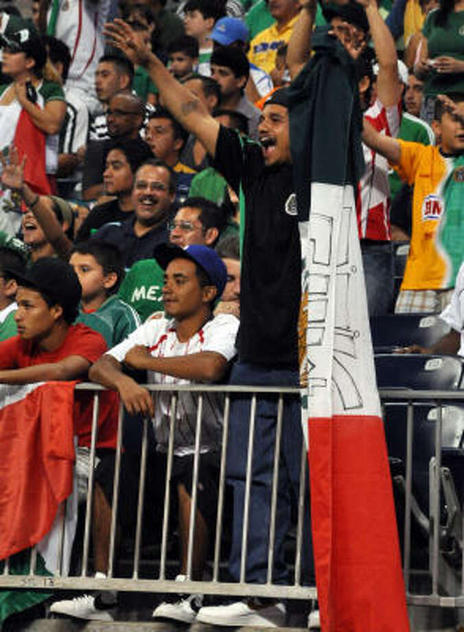 A rowdy Mexico fan heckles a Panama player for allegedly taking a dive. Photo: Chris Elliott
