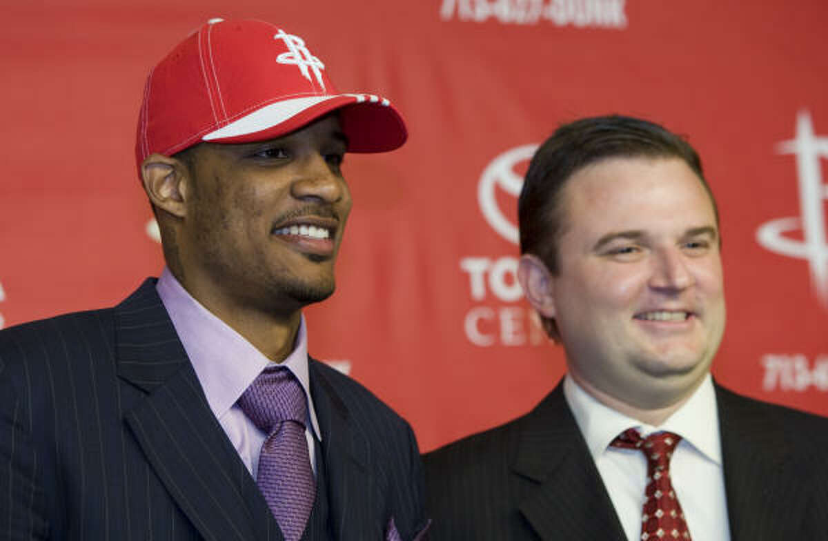 NBA signings Trevor Ariza stands with Houston Rockets general manager Daryl Morey as he is introduced as the newest Rockets player during a news conference Wednesday at Toyota Center. Ariza, a 6-8, 210-pound guard/forward, comes to the Rockets as a free agent from the the Los Angeles Lakers.