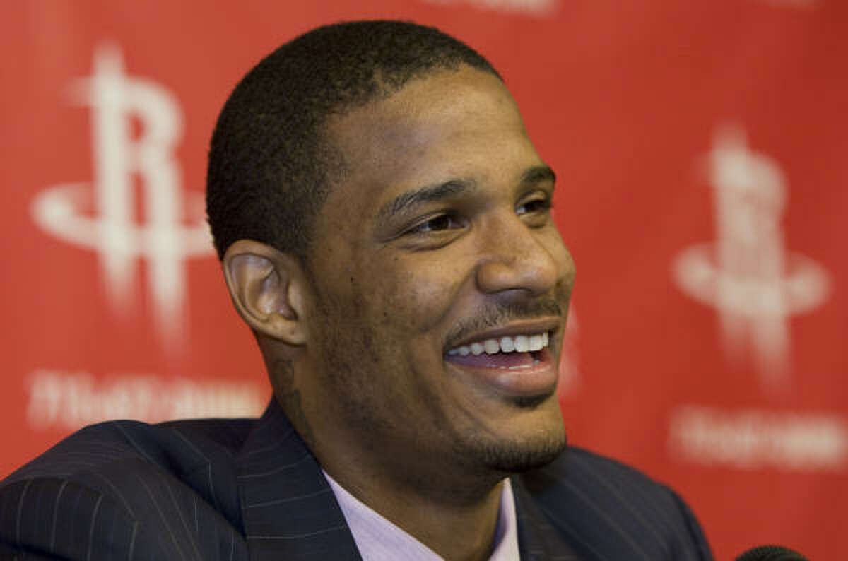 Ariza smiles as he prepares to speak during the news conference announcing his arrival in Houston.