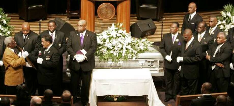 Members of the Omega Psi Phi fraternity take part in a memorial service for Steve McNair. Photo: George Walker IV, AP